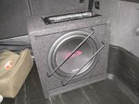 Установка сабвуфера Alpine SBG-1044BR в Audi Q5