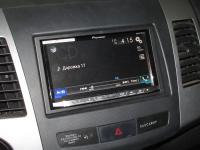 Фотография установки магнитолы Pioneer AVH-X8800BT в Mitsubishi Outlander XL