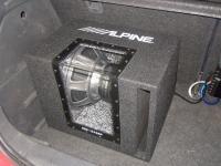 Установка сабвуфера Alpine SBE-1243BP в SsangYong Actyon