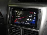 Фотография установки магнитолы Pioneer MVH-AV180 в Subaru Impreza