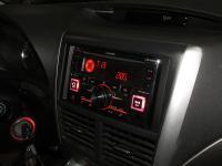 Фотография установки магнитолы Alpine CDE-W296BT в Subaru Forester (SH)