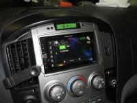 Фотография установки магнитолы Pioneer MVH-AV190 в Hyundai Grand Starex
