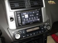 Фотография установки магнитолы Alpine INE-W920R в Toyota Land Cruiser 150
