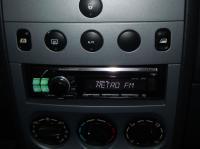 Фотография установки магнитолы Alpine CDE-111R в Peugeot Partner