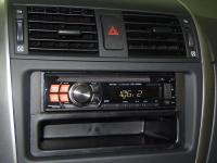 Фотография установки магнитолы Alpine CDE-120RM в Toyota Corolla X