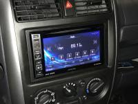 Фотография установки магнитолы Alpine INE-W990HDMI в Suzuki Jimny