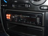 Фотография установки магнитолы Alpine CDE-120RM в Chevrolet Lanos