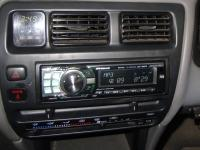 Фотография установки магнитолы Alpine CDE-9880R в Toyota Corolla