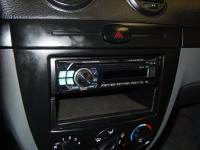 Фотография установки магнитолы Alpine CDE-111R в Chevrolet Lacetti