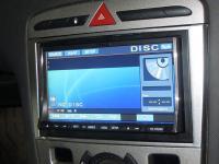 Фотография установки магнитолы Alpine IVA-W520R в Peugeot 308