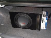 Установка сабвуфера Alpine SWR-1023D в Mitsubishi Lancer