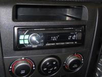 Фотография установки магнитолы Alpine CDE-111R в Mazda 3