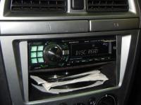 Фотография установки магнитолы Alpine CDE-9880R в Subaru Impreza