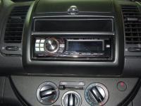 Фотография установки магнитолы Alpine CDE-9880R в Nissan Note