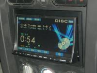 Фотография установки магнитолы Alpine IVA-W520R в Ford Mustang