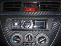 Фотография установки магнитолы Alpine iDA-X313 в Mitsubishi Lancer