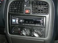 Фотография установки магнитолы Alpine CDE-131R в Mitsubishi Lancer