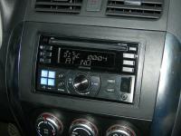 Фотография установки магнитолы Alpine CDE-W233R в Suzuki SX4