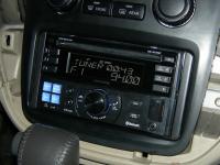 Фотография установки магнитолы Alpine CDE-W235BT в Toyota Highlander