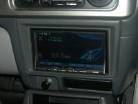 Фотография установки магнитолы Alpine INA-W910R в Mitsubishi Pajero Sport