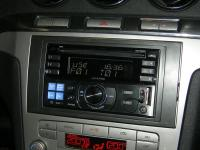 Фотография установки магнитолы Alpine CDE-W233R в Ford S-MAX