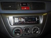 Фотография установки магнитолы Alpine CDE-9880R в Mitsubishi Lancer Evolution