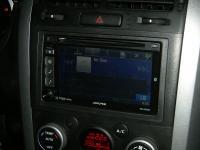 Фотография установки магнитолы Alpine INE-W920R в Suzuki Grand Vitara