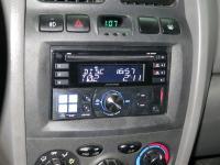 Фотография установки магнитолы Alpine CDE-W233R в Hyundai Santa Fe