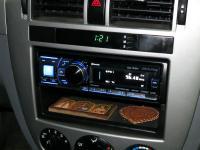 Фотография установки магнитолы Alpine CDA-137BTi в Chevrolet Lacetti