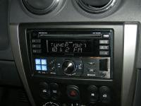 Фотография установки магнитолы Alpine CDE-W235BT в Nissan Almera III (G15)
