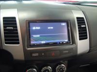 Фотография установки магнитолы Sony XAV-E70BT в Peugeot 4007