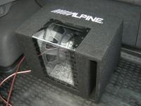 Установка сабвуфера Alpine SBG-1244BP в Mazda Atenza