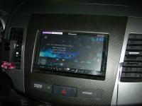 Фотография установки магнитолы Pioneer AVH-X4500DVD в Mitsubishi Outlander XL