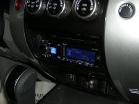 Фотография установки магнитолы Alpine CDE-178BT в Mitsubishi Pajero Sport