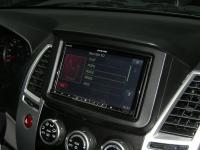 Фотография установки магнитолы Alpine INE-W977BT в Mitsubishi Pajero Sport
