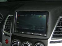 Фотография установки магнитолы Alpine INE-W928R в Mitsubishi Pajero Sport