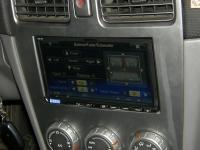 Фотография установки магнитолы Alpine ICS-X8 в Subaru Forester (SG)