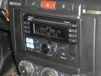 Фотография установки магнитолы Alpine CDE-W235BT в Land Rover Freelander 2