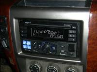 Фотография установки магнитолы Alpine CDE-W235BT в Nissan Patrol