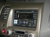 Фотография установки магнитолы Alpine CDE-W235BT в Honda Civic 4D