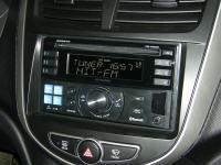 Фотография установки магнитолы Alpine CDE-W235BT в Hyundai Solaris