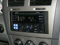 Фотография установки магнитолы Alpine CDE-W235BT в Dodge Avenger