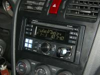 Фотография установки магнитолы Alpine CDE-W235BT в Subaru Forester (SJ)