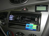 Фотография установки магнитолы Alpine CDE-123R в Ford Focus