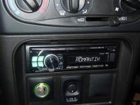Фотография установки магнитолы Alpine CDE-111R в Chevrolet Niva