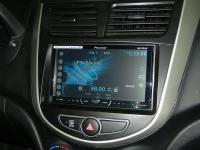 Фотография установки магнитолы Pioneer AVH-X4600DVD в Hyundai Solaris