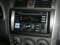 Фотография установки магнитолы Alpine CDE-W235BT в Toyota Corolla X