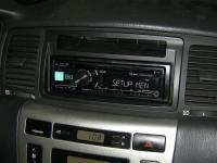 Фотография установки магнитолы Alpine CDE-180R в Toyota Corolla IX