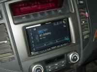 Фотография установки магнитолы Pioneer AVH-X8600BT в Mitsubishi Pajero IV