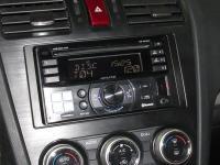 Фотография установки магнитолы Alpine CDE-W235BT в Subaru XV